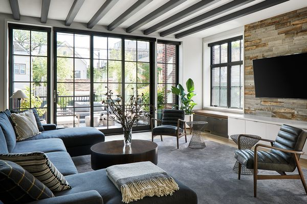Chic apartment living room with large windows.