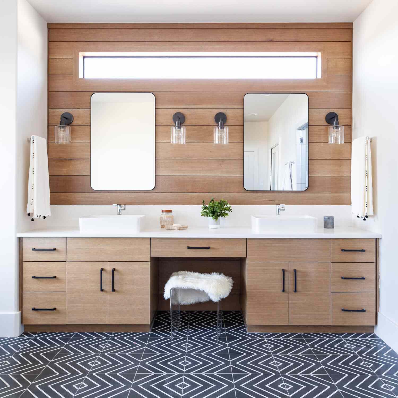 A bathroom with a wood-paneled vanity