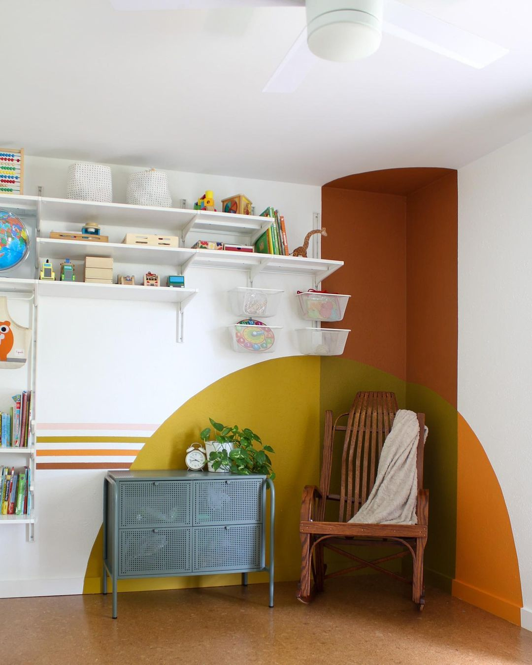 Painted arches around reading nook.