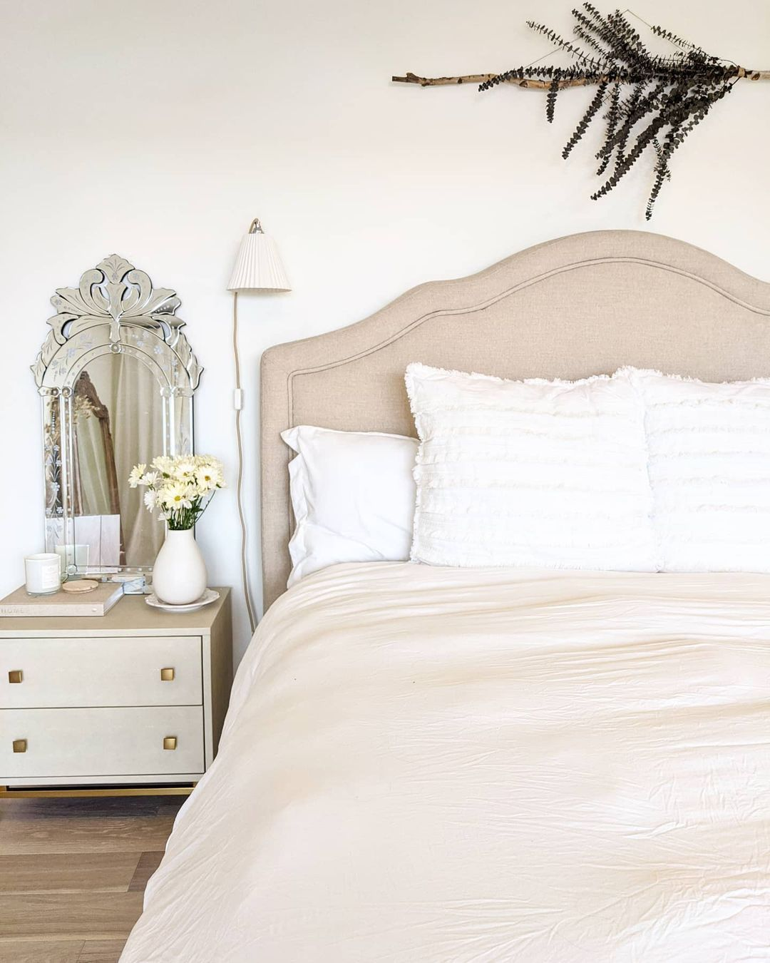 Soft neutral bedroom with a vintage feel.