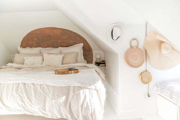 Sweet white attic with soft linen bed.