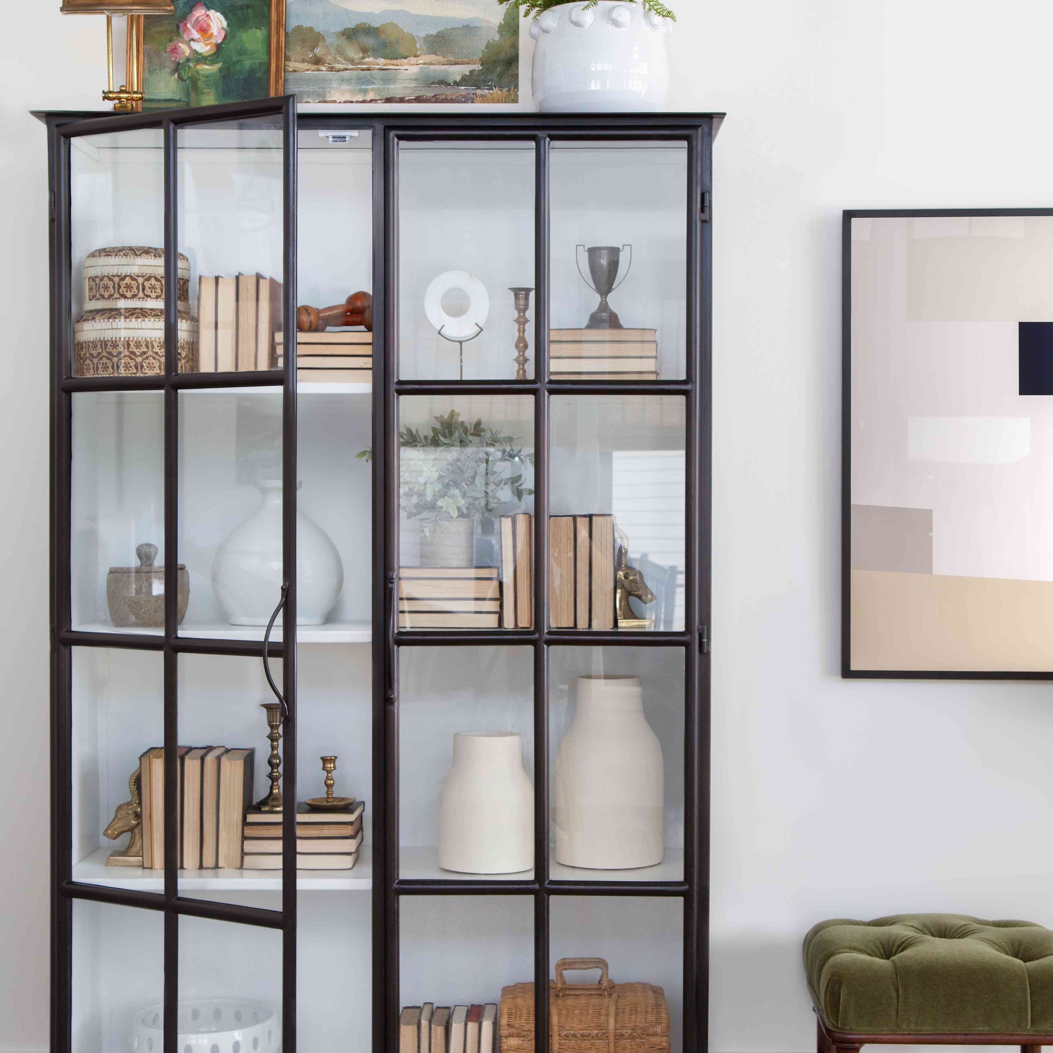 one room i'll never forget - fargo sunroom with bookcase and leaning art