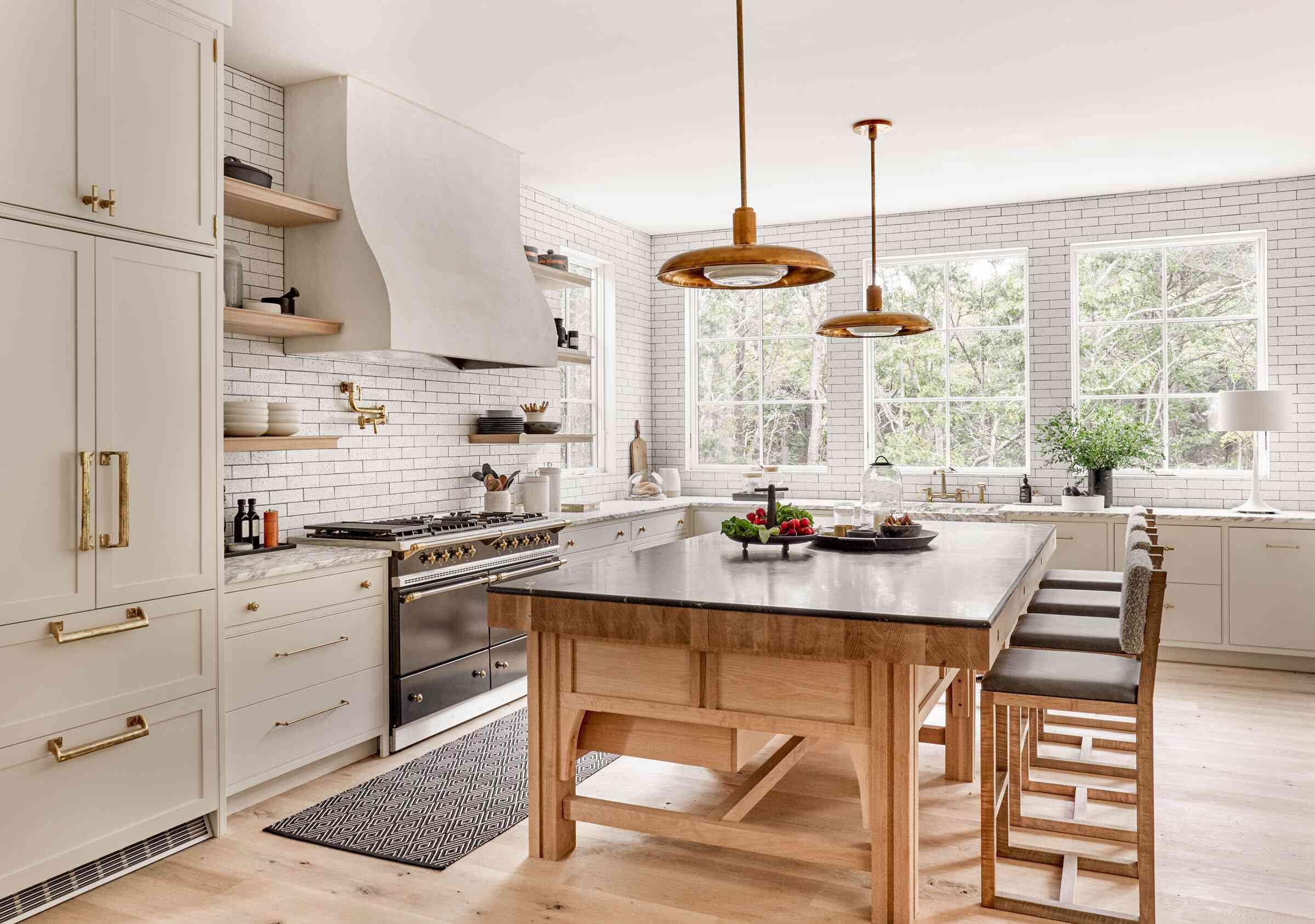 White kitchen with brick tile walls