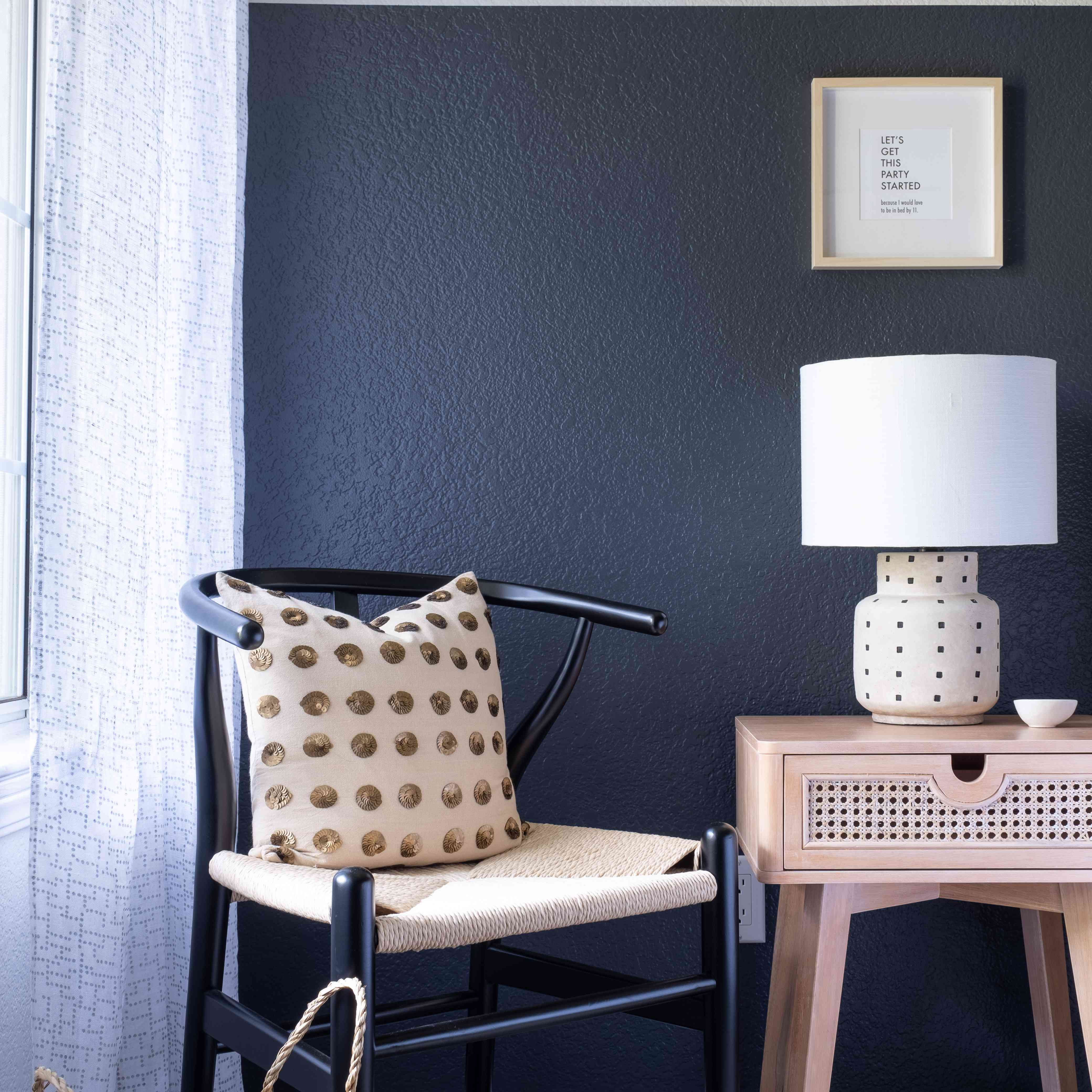 Sitting area with black and rattan accents.