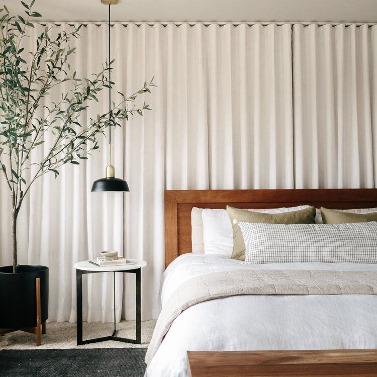 bedroom with wall-to-wall drapery