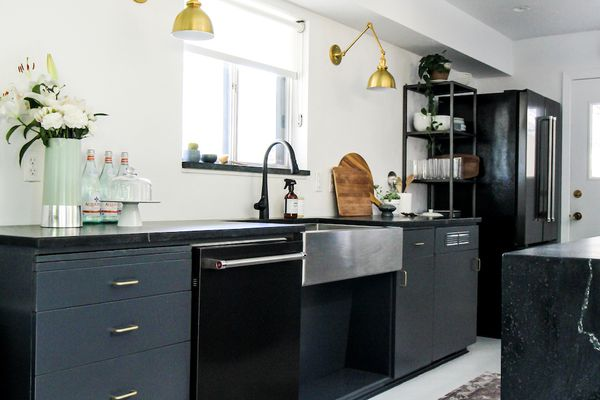 Kitchen with dark cabinets and white walls