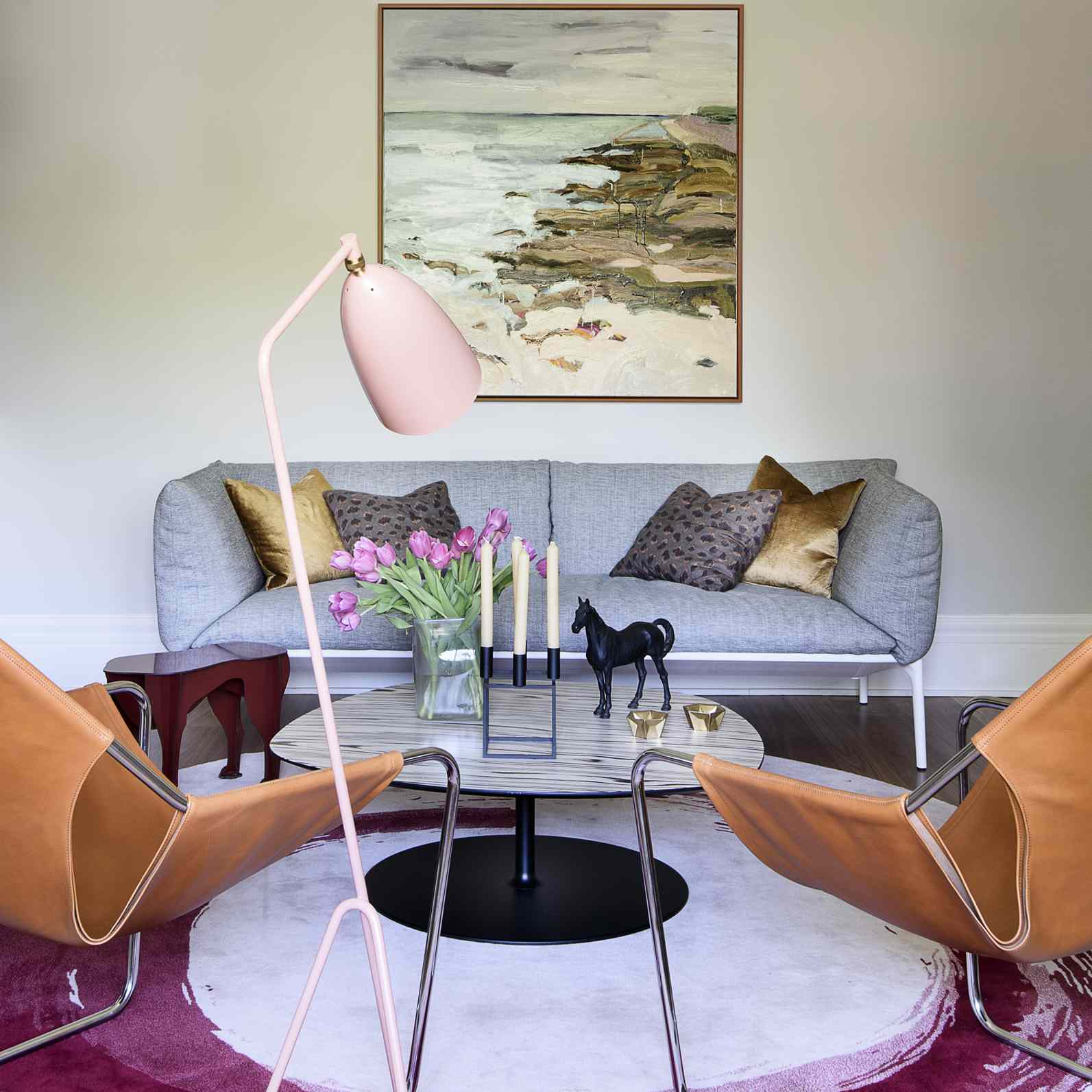 A mid-century style living area with a thoughtful mixture of high and low decorative items, artwork, and furniture.