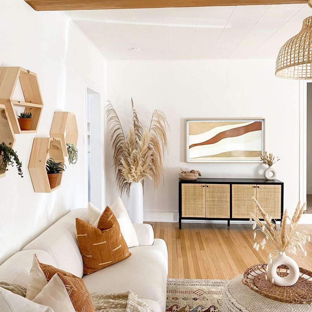 Neutral boho living room with dried pampas grass.