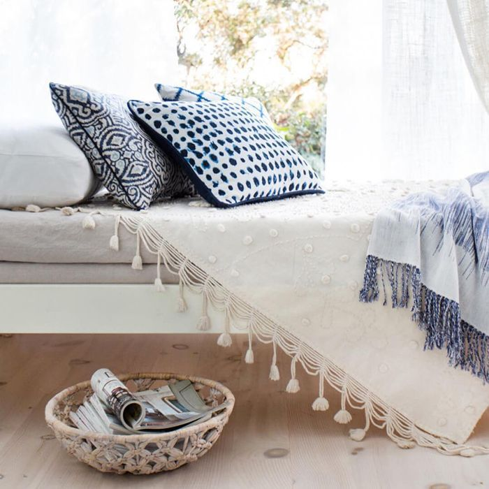 a window bench with pillows