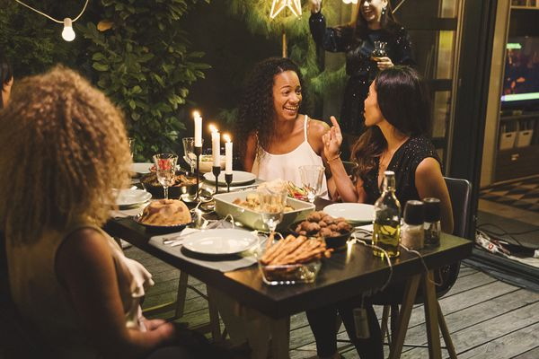 women at a dinner party