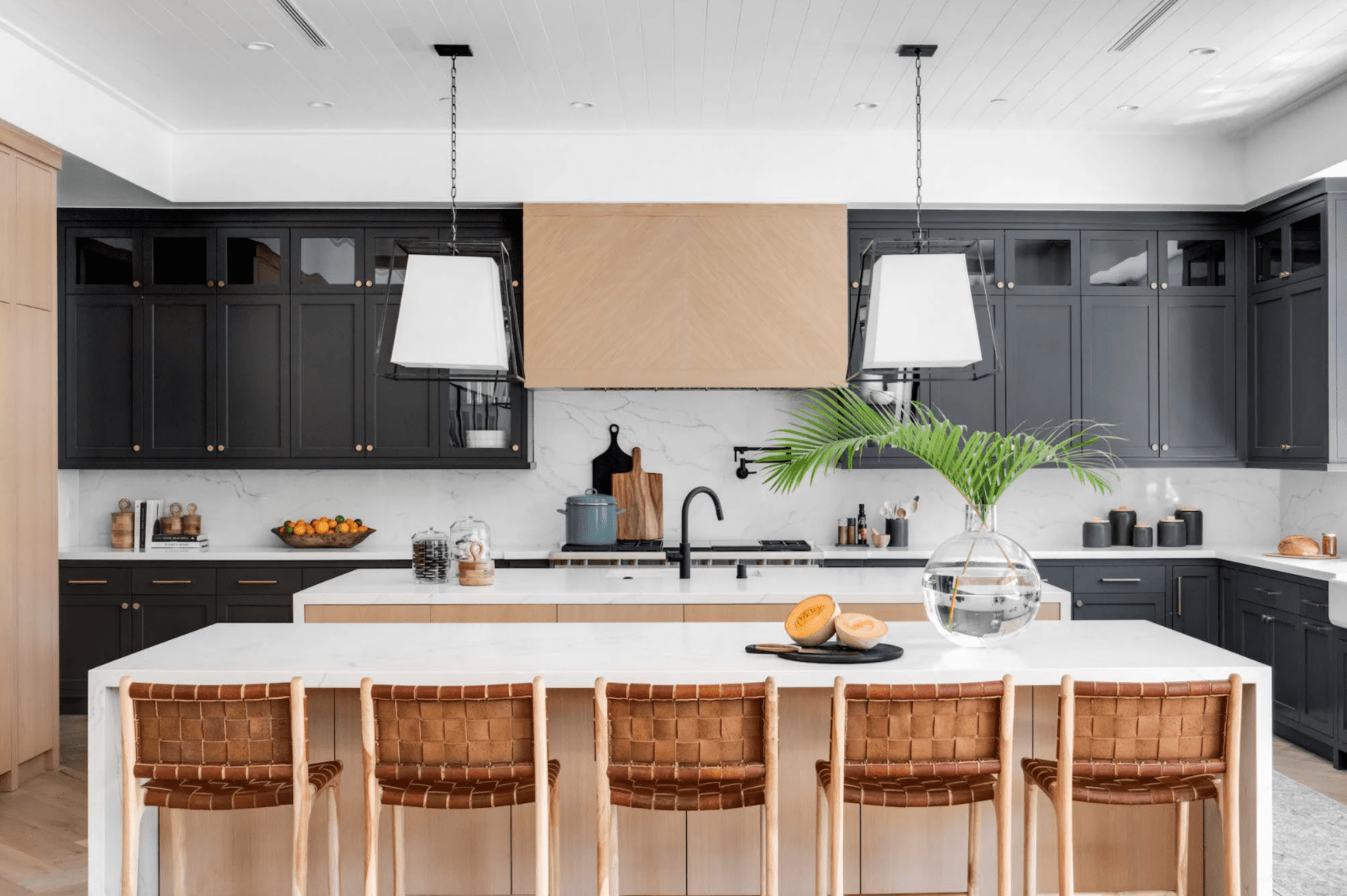 An open-concept kitchen with two kitchen islands