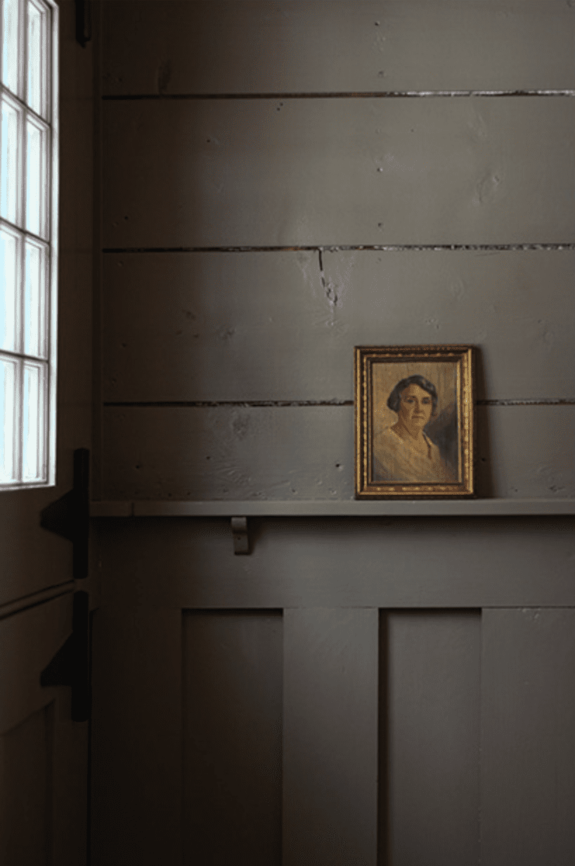 A dark gray wall with a painting on it