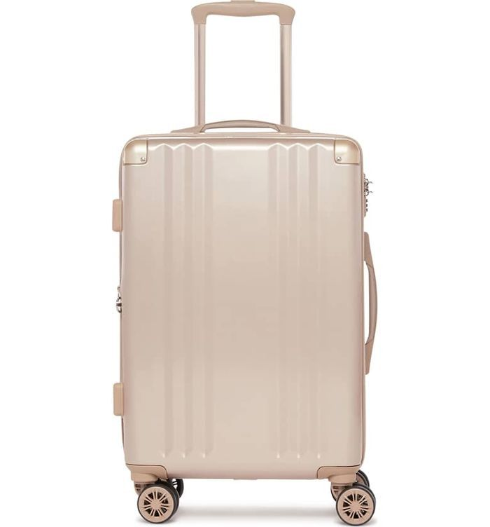 A pink suitcase with wheels and extended handle.
