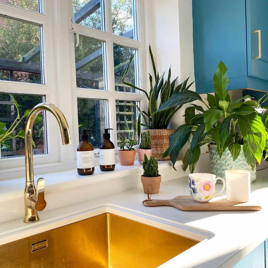 Blue cabinets and gold sink