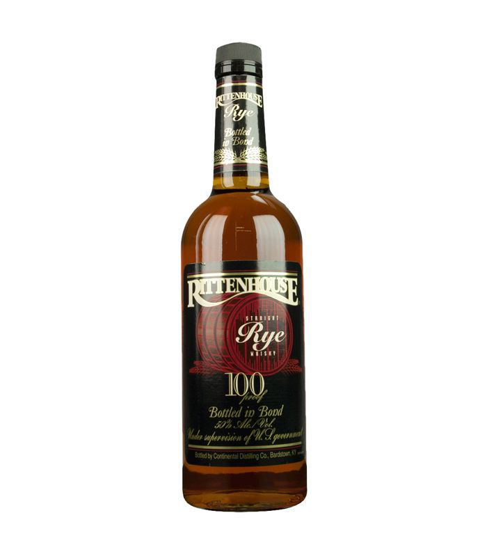 A bottle of Rittenhouse Rye 100 whiskey with a black top and label.