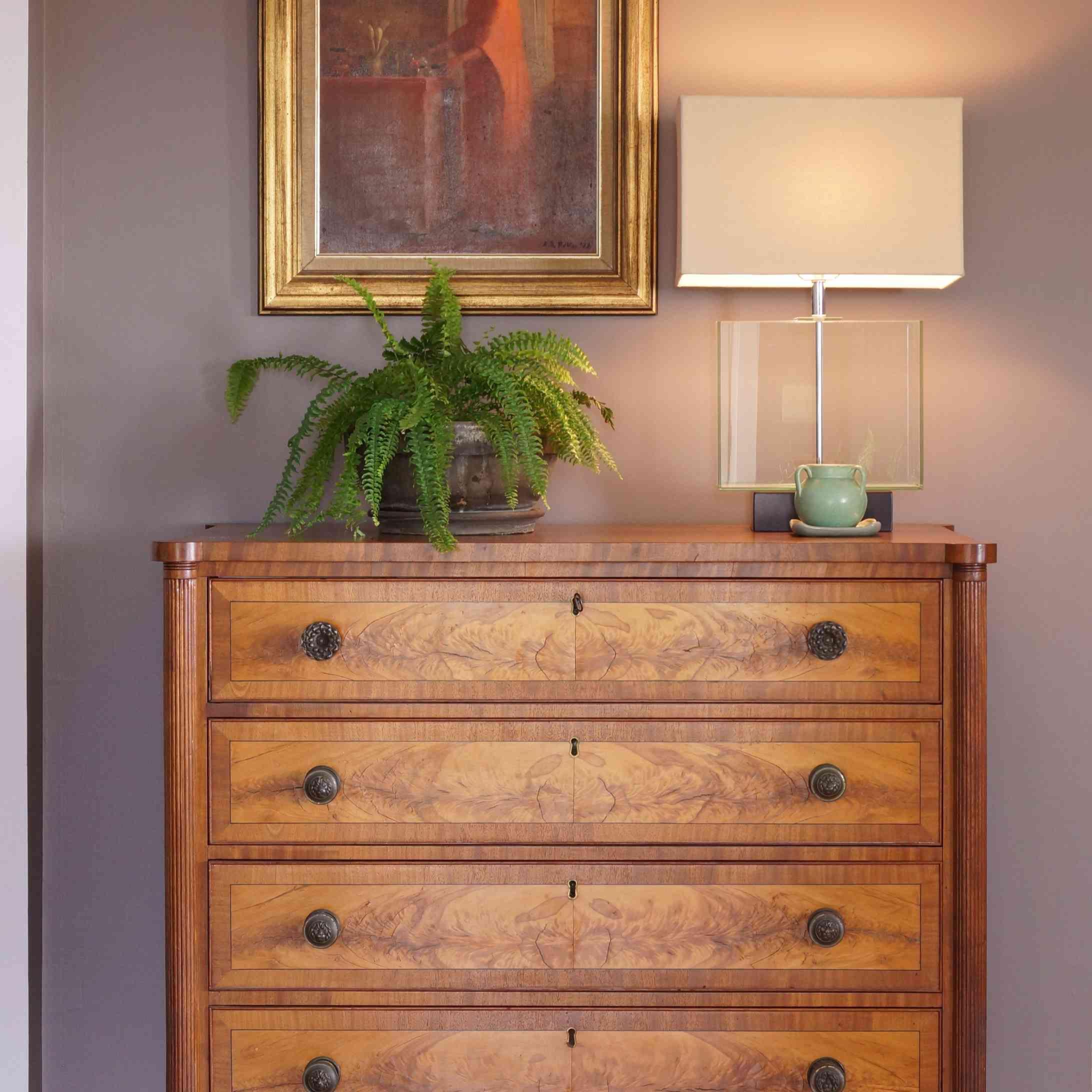 Dresser with art work above it