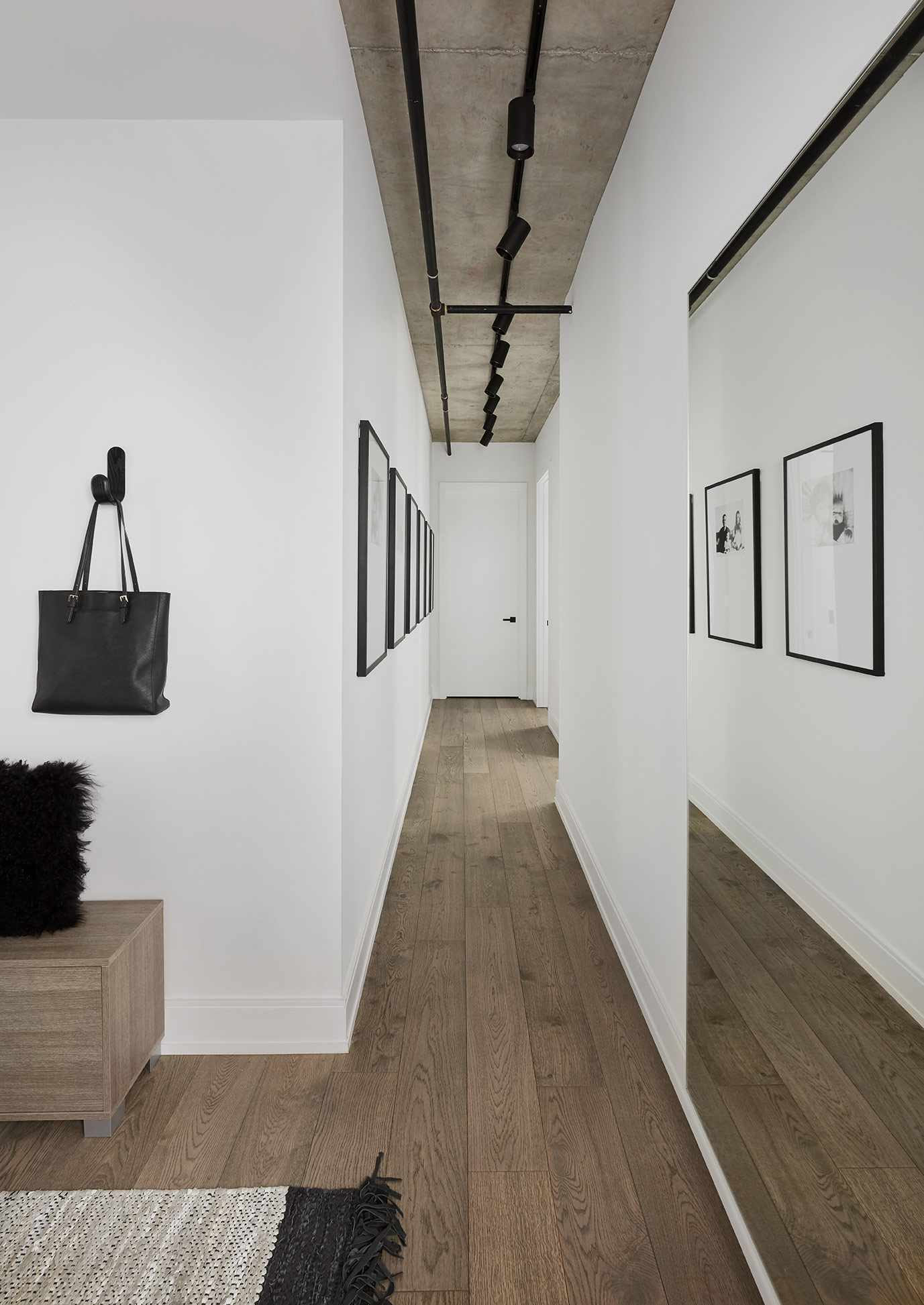 Hallway with straight line of hanging photos
