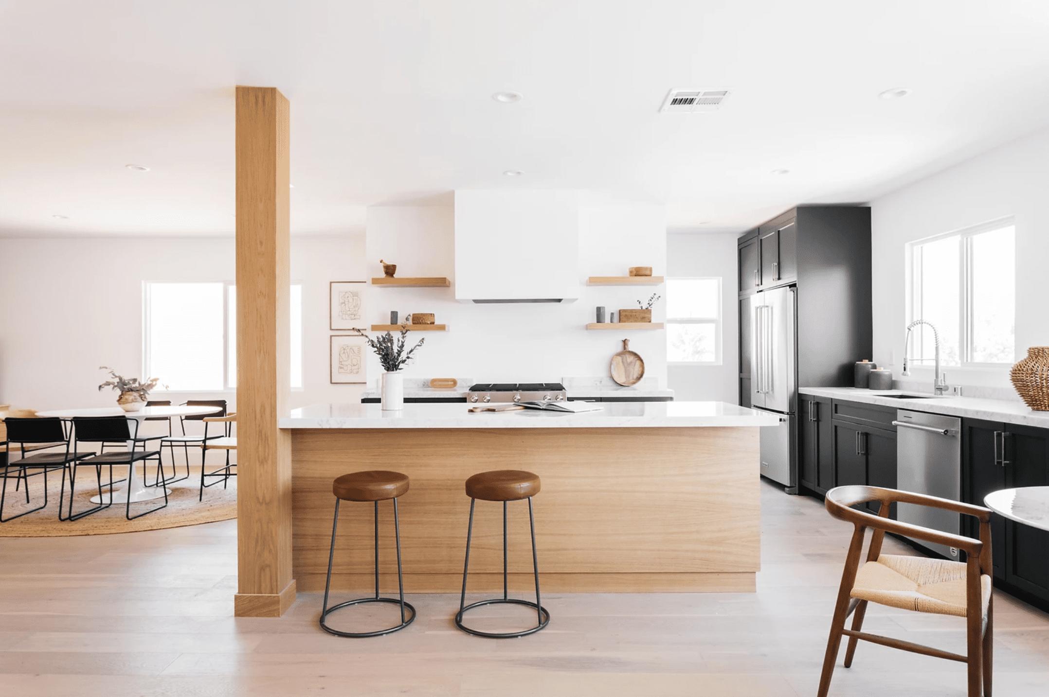 All white kitchen in white, brown, black palette