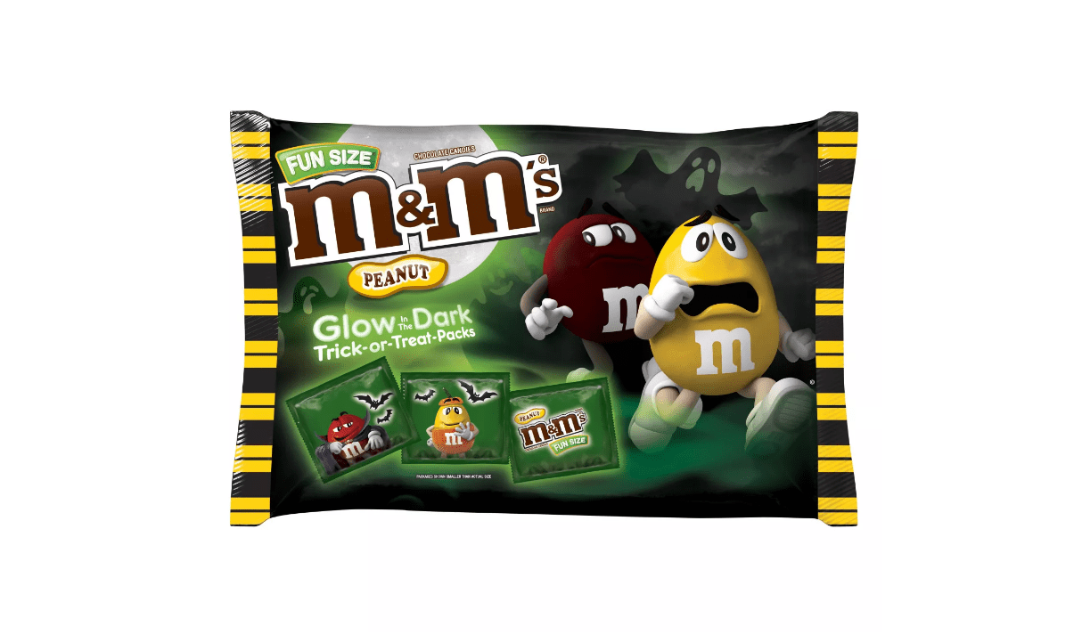 A bag full of Fun Size M&Ms with individual glow-in-the-dark packs.
