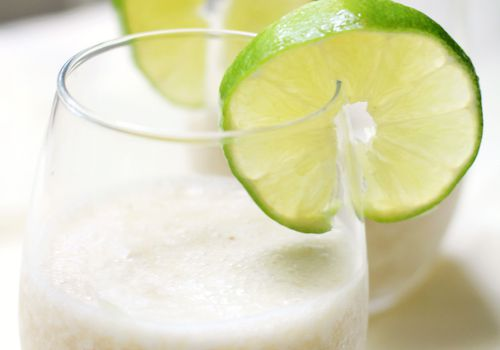 best mocktail recipes - Banana daiquiri garnished with lime wheel.