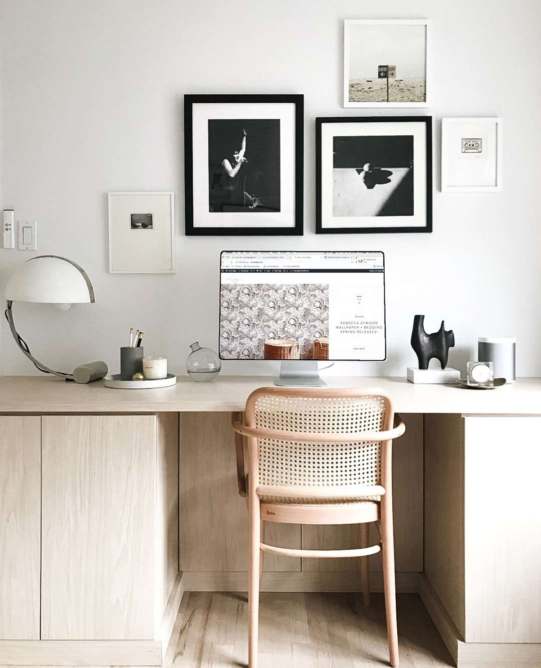 Office with black and white framed prints