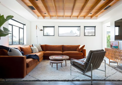 Bright yet cozy living room with an orange velvet sectional