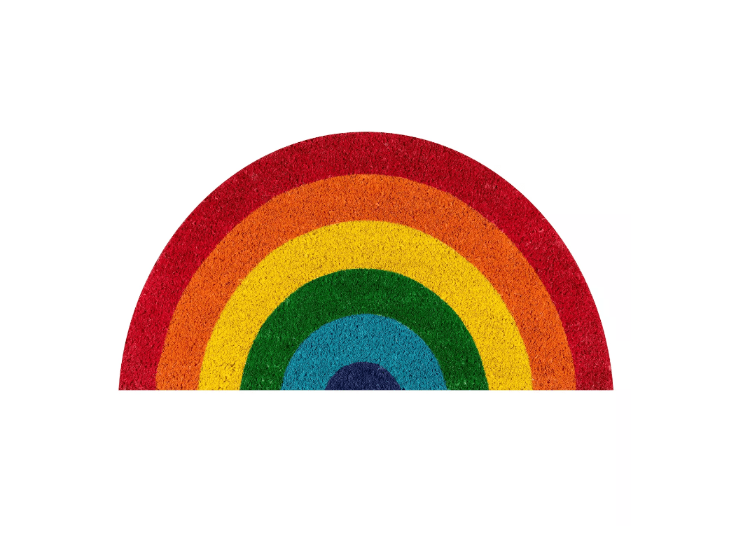 A coir doormat in the form of a rainbow.