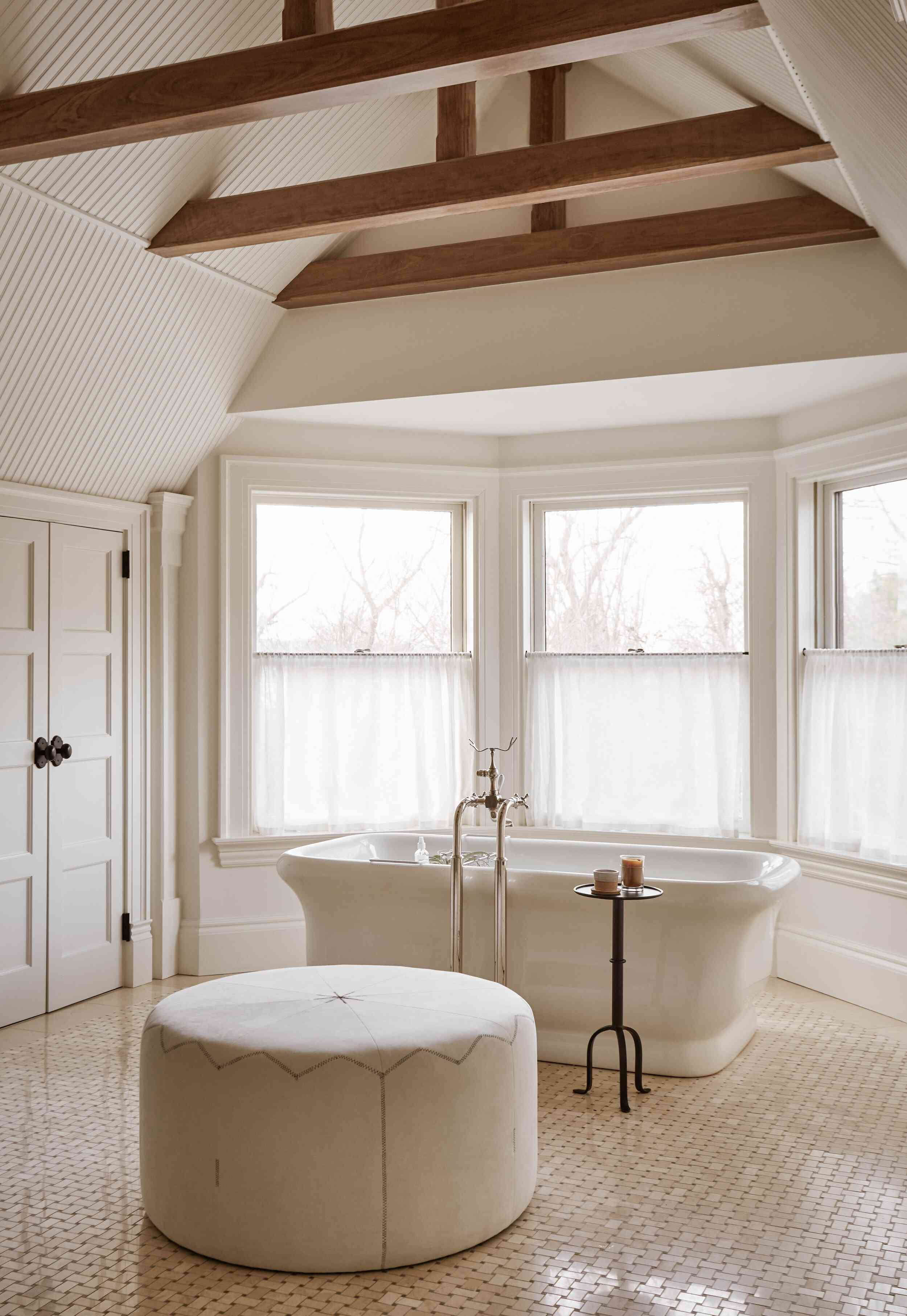 All white and cream large bathroom with large windows