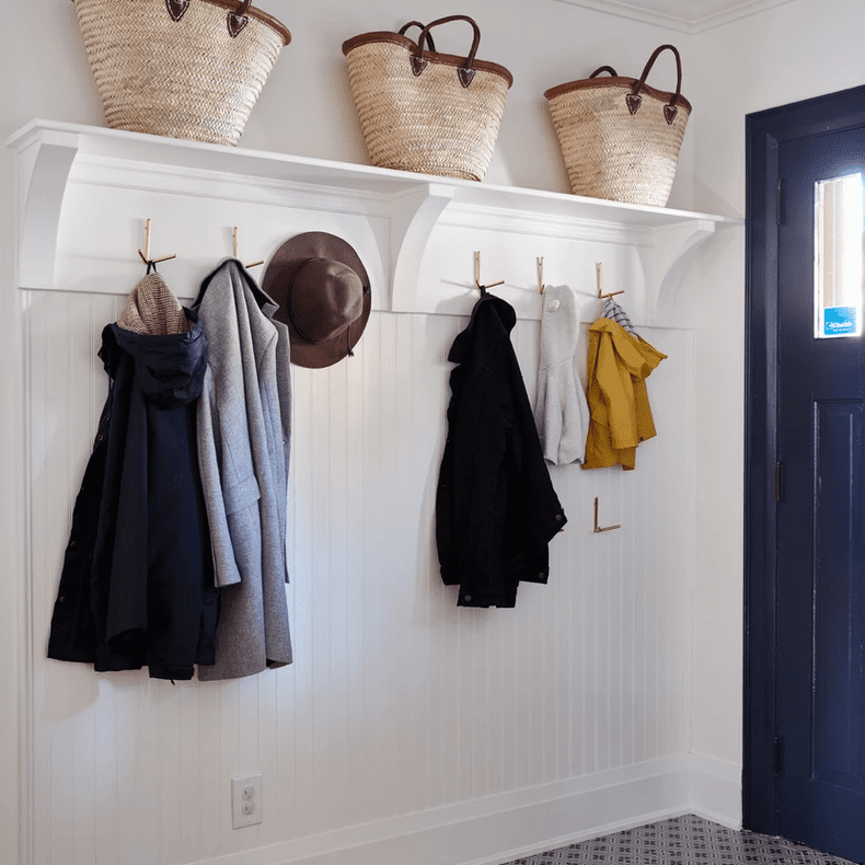 An entryway lined with shelves and hooks