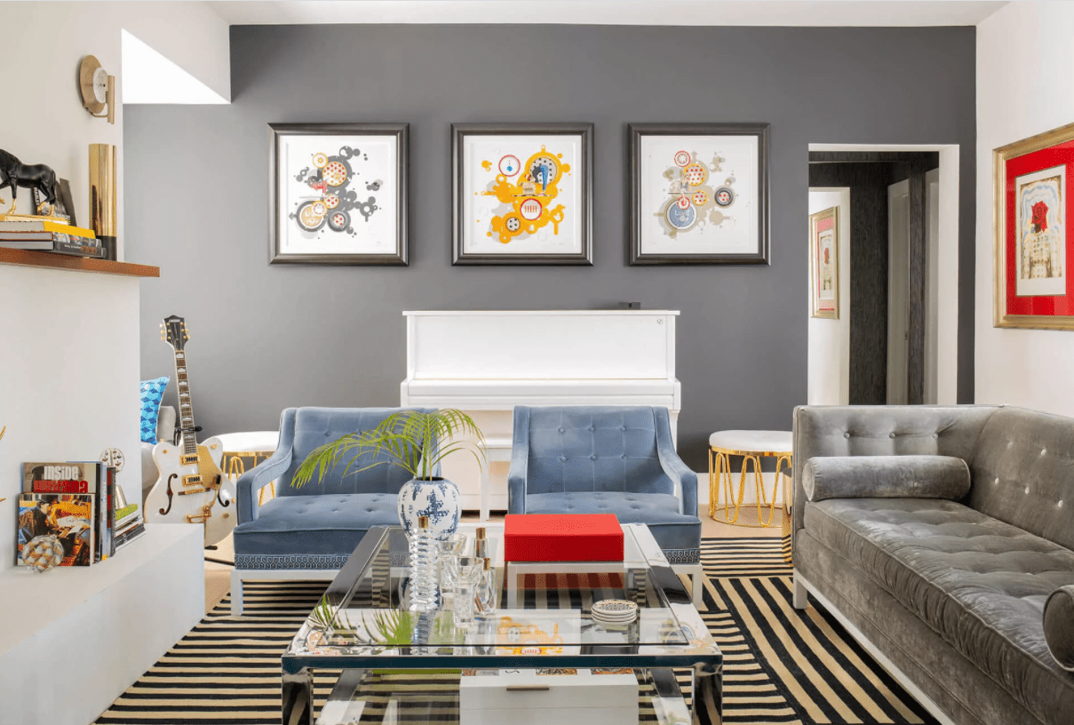 living room with gray sofa and wall