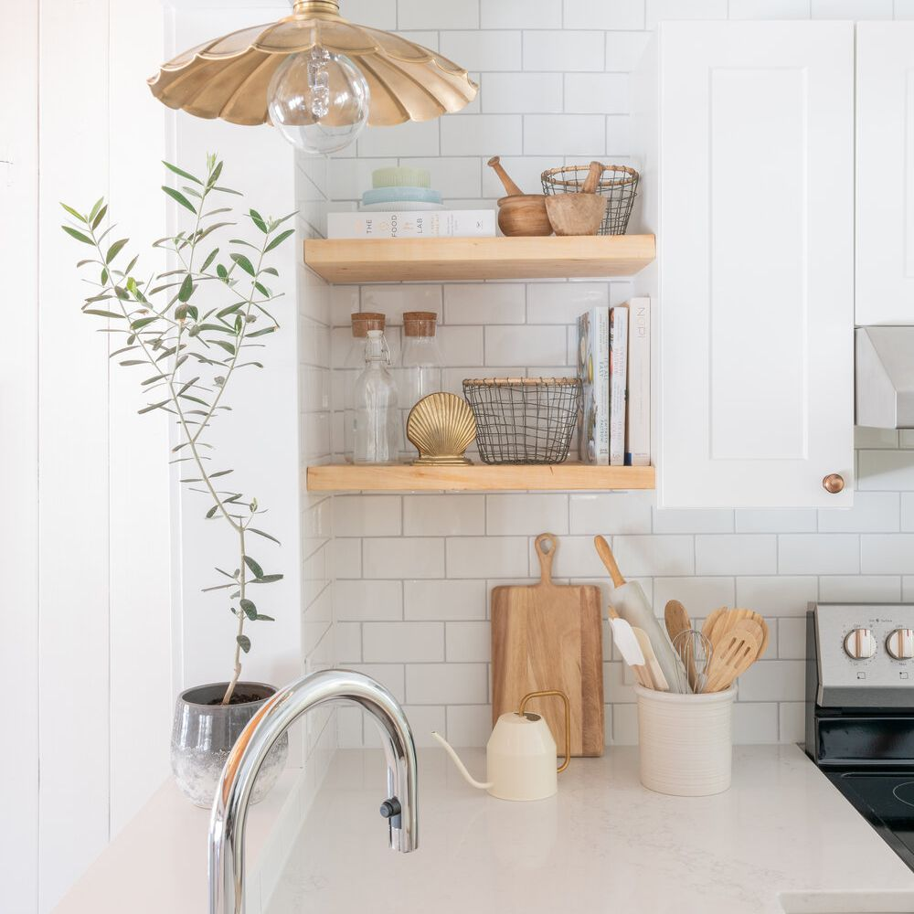 Beachy kitchen counter with open shelving.