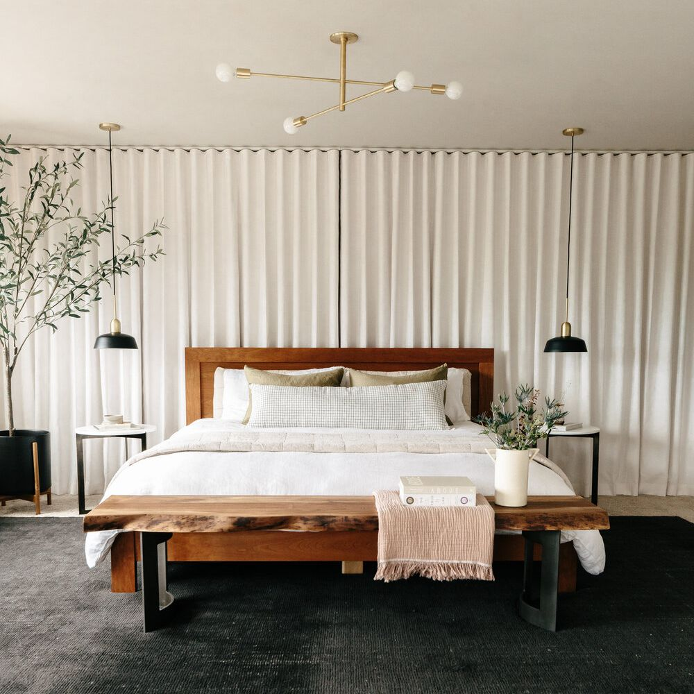 A bedroom filled with modern furniture and decor