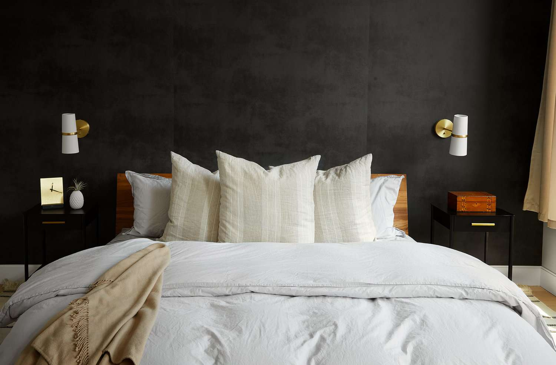 A bedroom with black walls