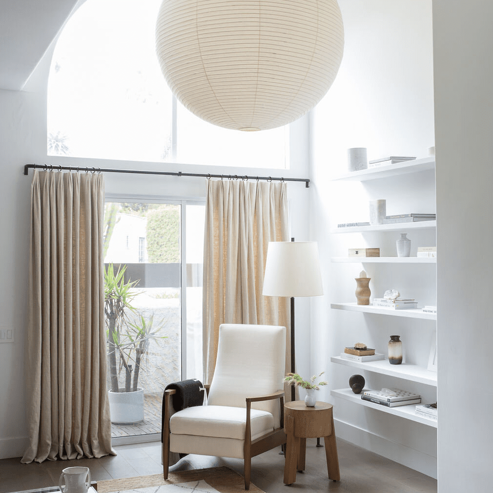 A living room corner adorned with several ivory fixtures