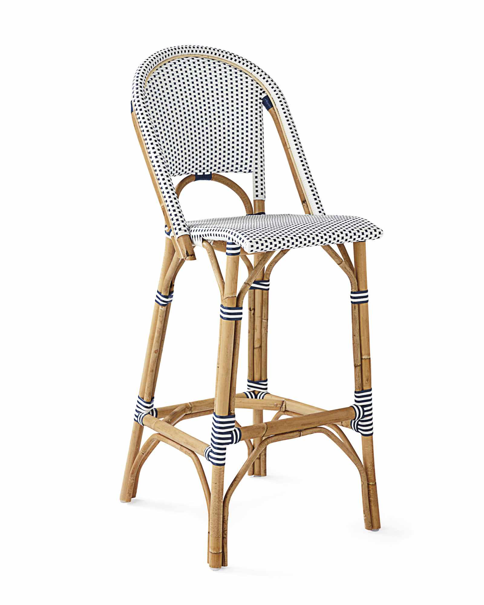 A blue and white wicker barstool