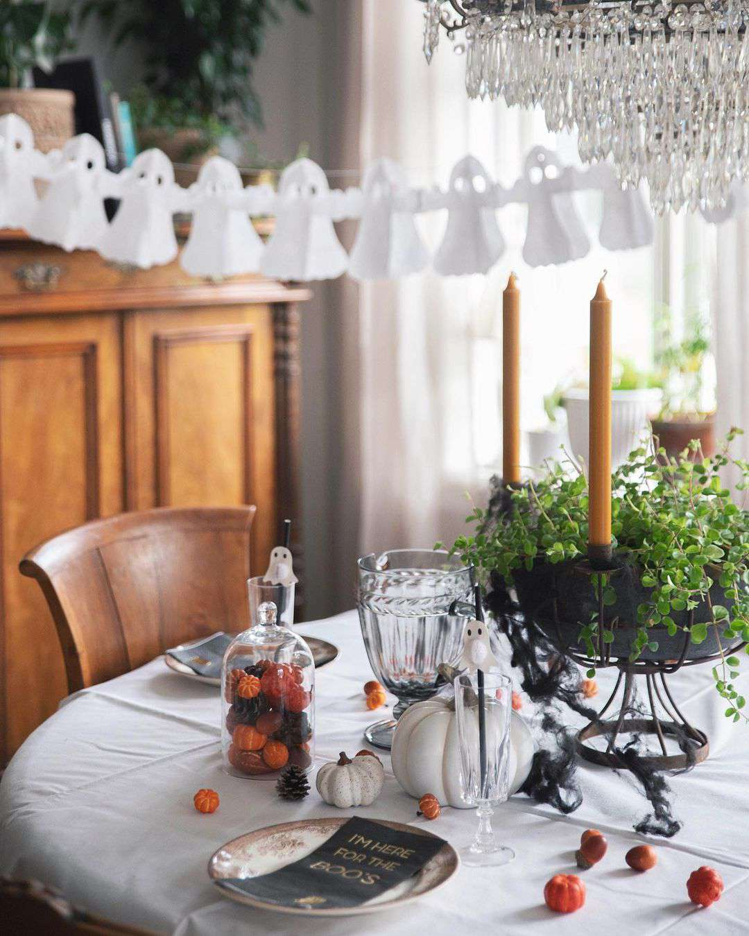 Dining table with paper ghosts