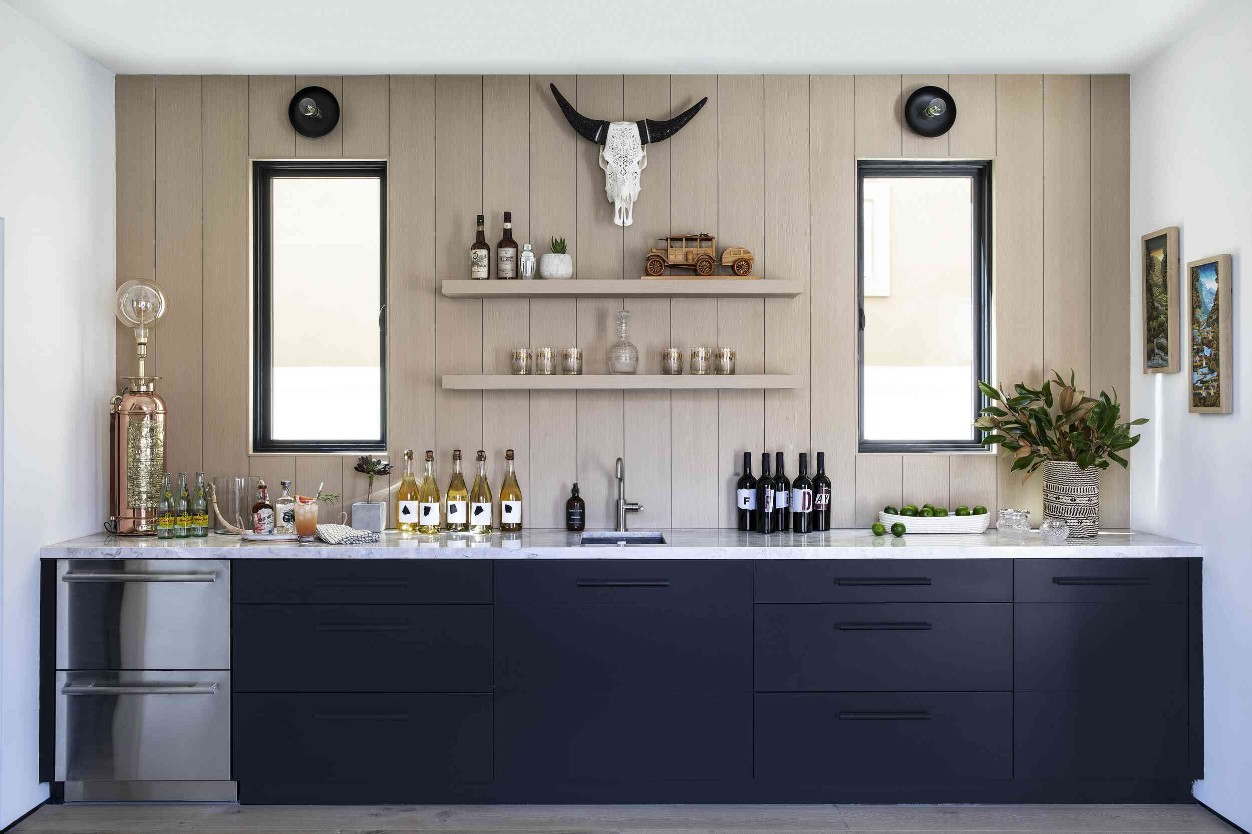A wet bar with a wood panel-lined backsplash and matching wooden shelves