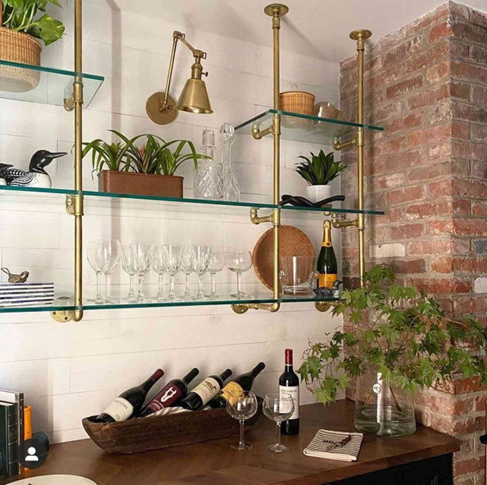 Glass shelves hanging in a kitchen