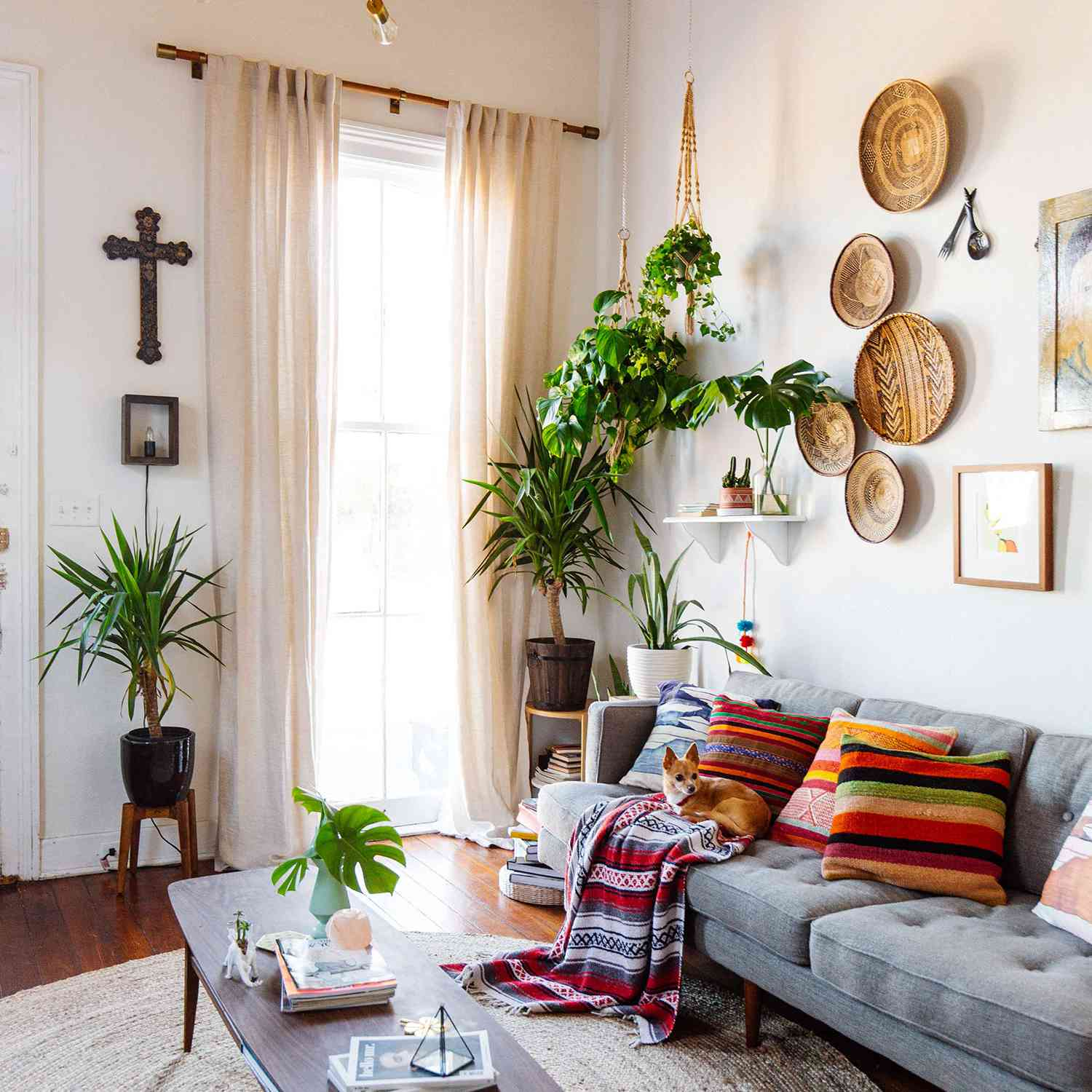 white living room with basket gallery wall and blue couch