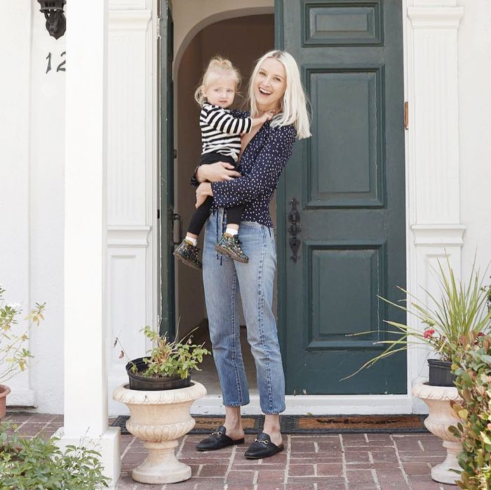 a mother and daughter in front of an home front door