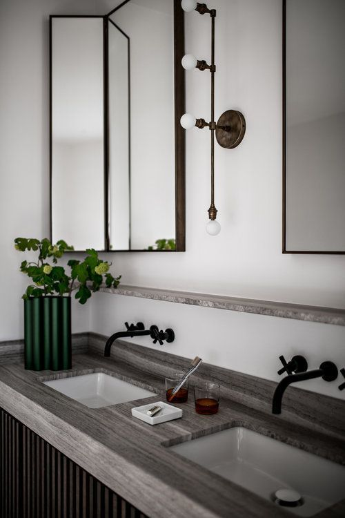 modern bathroom vanity with a gray stone top and industrial fixtures