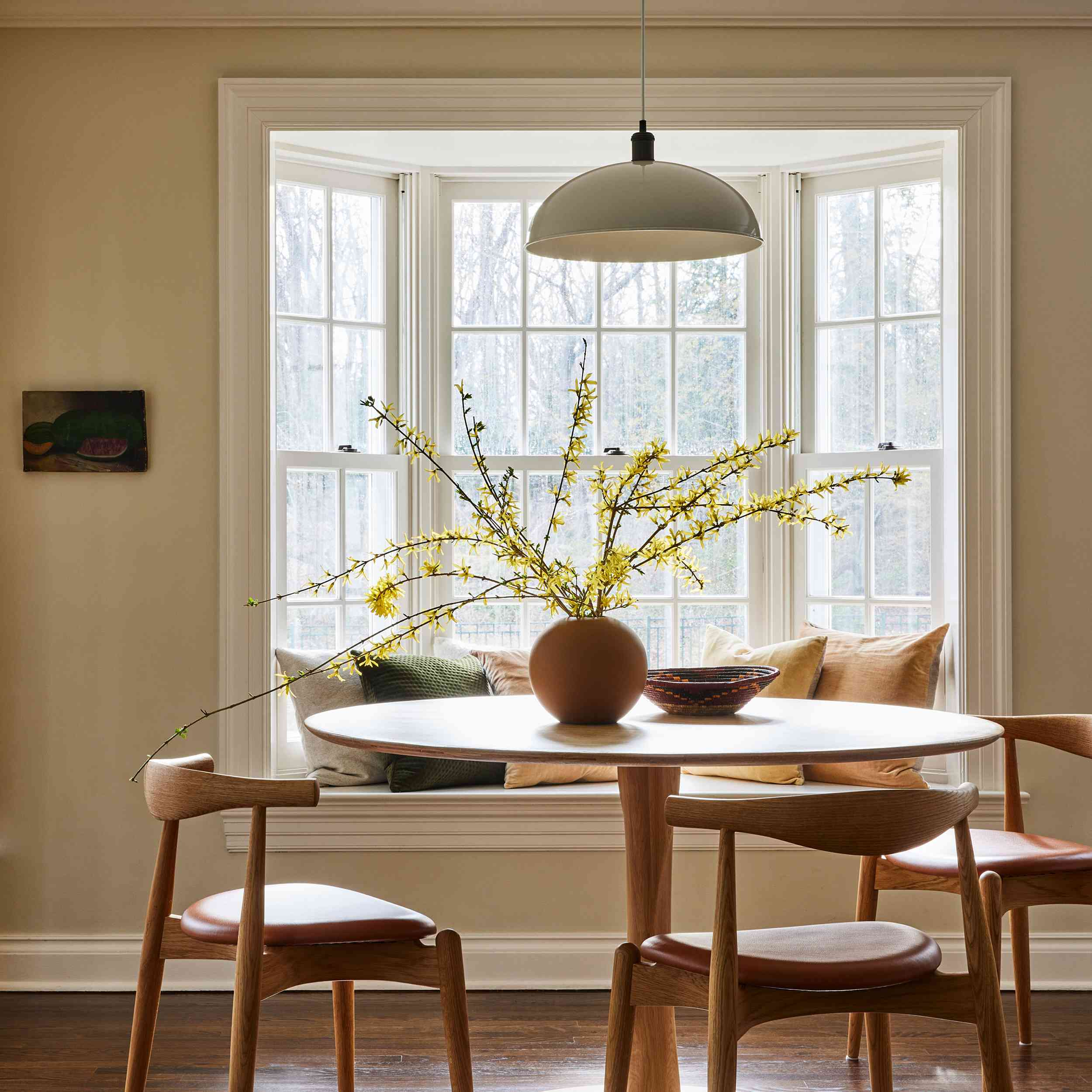 connecticut farmhouse home tour - breakfast area with built-in window seat