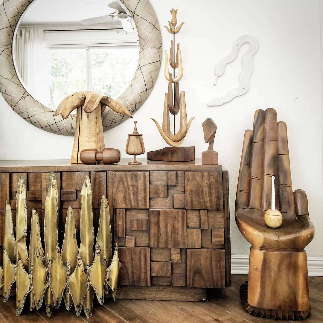 Wooden decor in shape of hands.