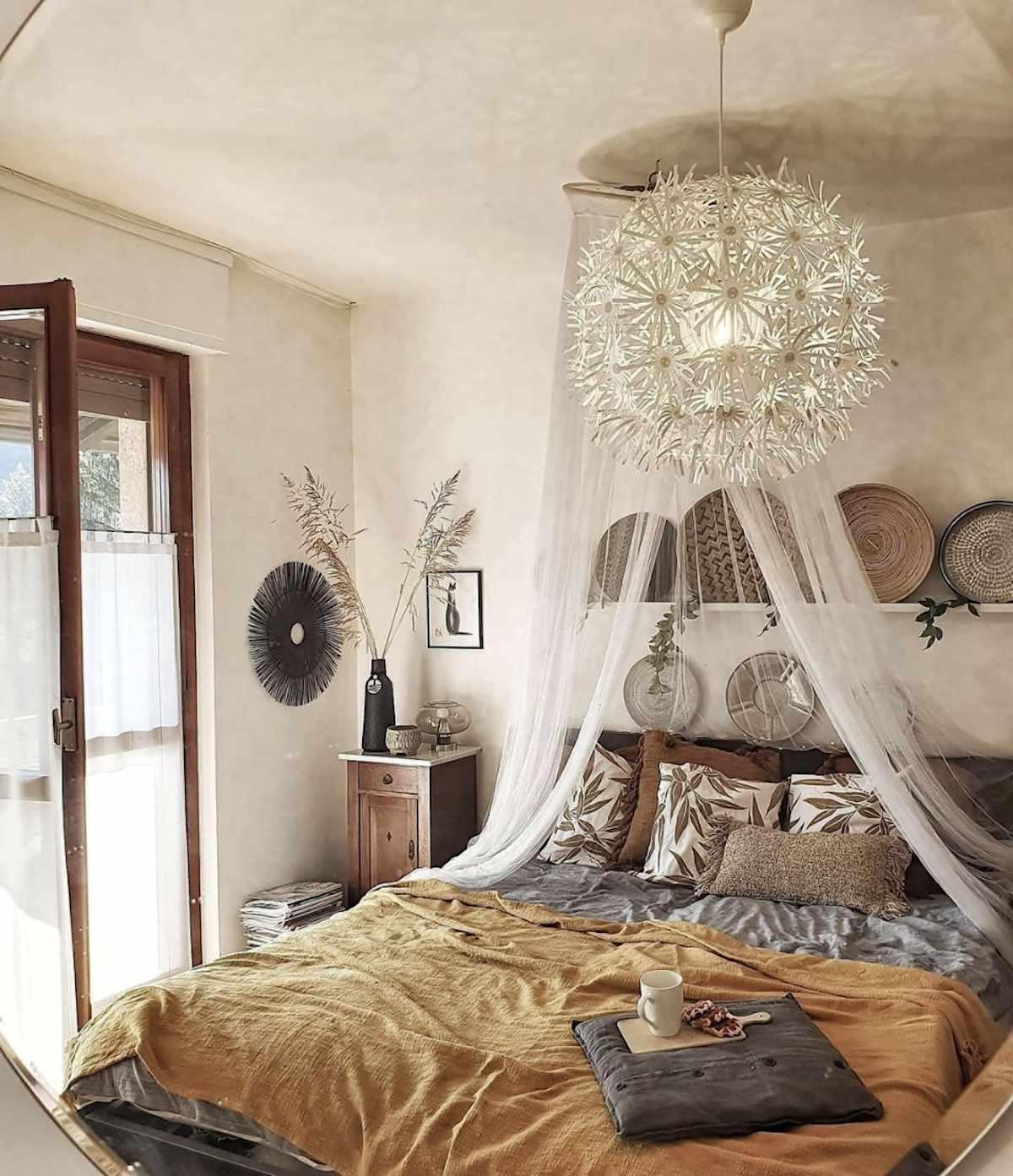boho bedroom with flowy canopy