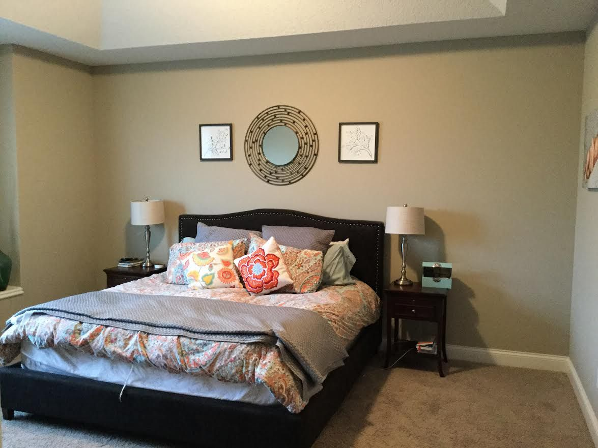 Before shot of the outdated bedroom.
