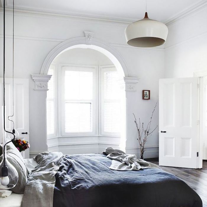 Easy Cozy Home Tips: Undone linens in an airy bedroom