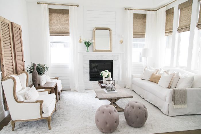 White and natural colored décor make up the formal living room