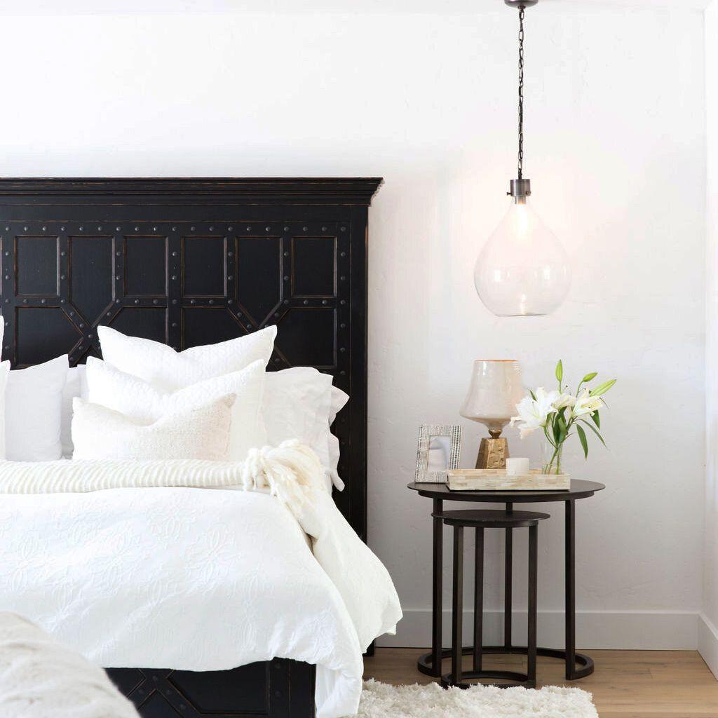 White bedroom with black bed frame