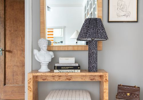 Entryway table with statement lamp.