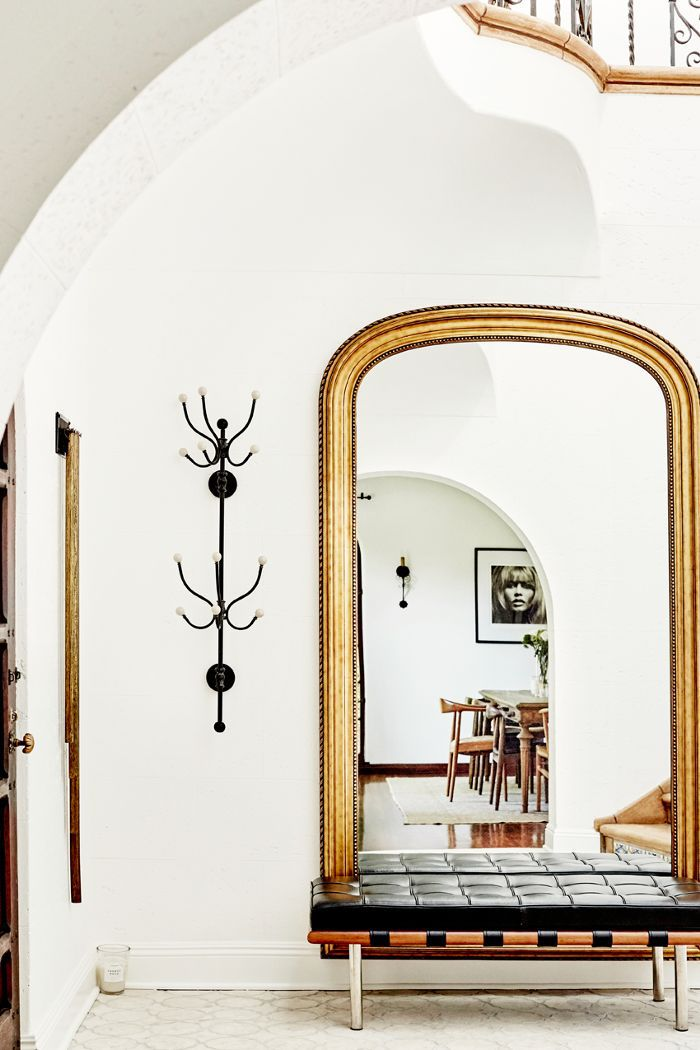Accent pieces and mirrors serve as artwork in an entryway